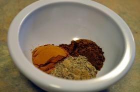 Ground cinnamon, cloves, and cardamom