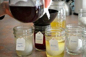 Once it has cooled in the big jar, pour the dye into the little egg jars