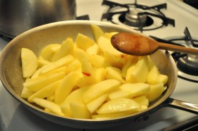 Cook the apples in melted butter in a skillet