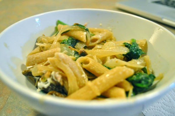 Whole wheat pasta and spinach with onion and goat cheese sauce
